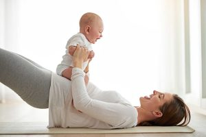 04-ways-new-moms-can-sneak-in-postpartum-exercise-with-baby-541865110_cecilie_arcurs